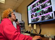 A Cincinnati VA employee monitors Veterans in the ICU via the Virtual Telesitter Solution.