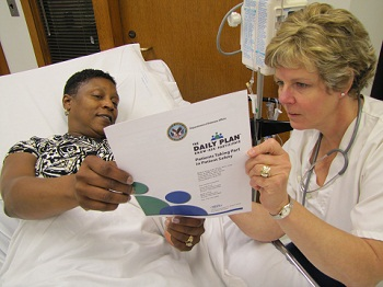 A patient and health care provider discuss patient's Daily Plan®