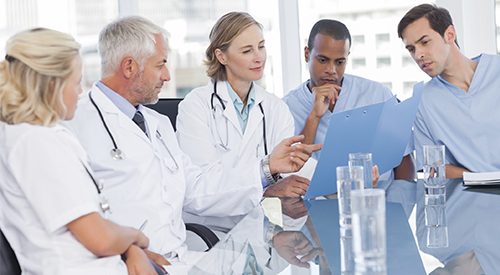 A number of clinicians discuss a medical issue.