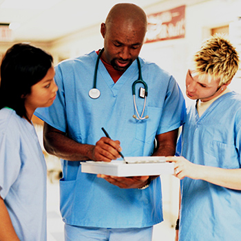 Three health care providers discuss a medical record